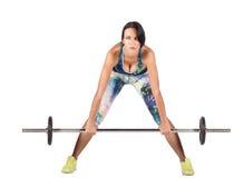 Спорт женщины фитнеса работая сидения на корточках с гантелями Стоковое Фото