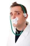 спрашивающ доктору смешную помощь стоковые фото