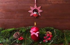Спрус украшения рождества с свечой Стоковая Фотография