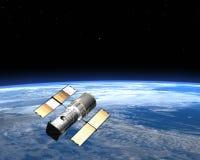 Спутник связи двигая по орбите земля в космосе Стоковые Фото