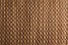 Сплетенная бамбуком предпосылка коричневой циновки handmade Стоковое Фото