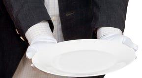 Сразу взгляд пустой белой плиты в руке в перчатках Стоковые Изображения