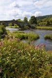 Средневековый мост Pont Fawr, старый коттедж, Llanrwst Стоковые Изображения RF