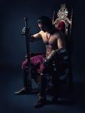 Средневековый принц на троне стоковые фотографии rf