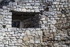 Средневековая каменная стена с окном Стоковая Фотография RF
