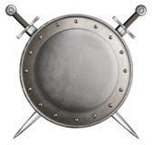 Средневековый круглый экран при 2 изолированной шпаги стоковое фото rf
