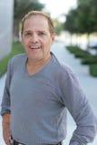 Средний постаретый усмехаться человека Стоковая Фотография