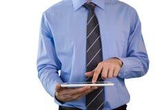 Средний раздел бизнесмена используя ПК таблетки Стоковое Изображение