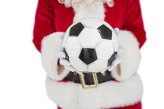 Средний раздел santa держа футбол Стоковые Фотографии RF