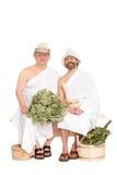 Средн-постаретые люди в костюмах русской сауны купая стоковые фотографии rf
