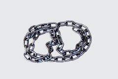 Стальная цепь на белой предпосылке стоковое изображение