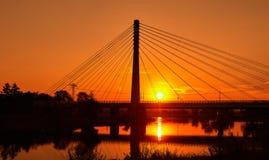 Стальной канатный мост на восходе солнца стоковые изображения
