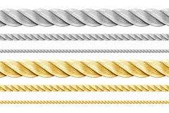 Стальные и золотистые веревочки установили изолировано стоковая фотография