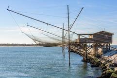 Станция рыбной ловли в запруде Sottomarina, Италии Стоковое фото RF