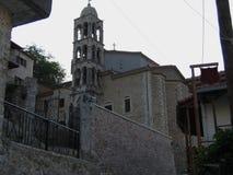 Старая башня с часами на городке Dimitsana в Пелопоннесе Греции Стоковое Изображение