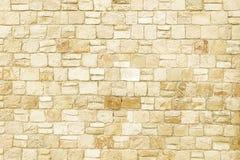 Старая бежевая текстура предпосылки каменной стены Стоковое Изображение RF