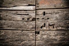 Старая дверь с keyholes Стоковое Изображение