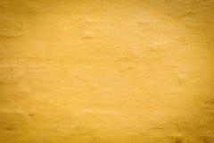 Старая винтажная желтая предпосылка каменной стены backhander стоковое фото rf