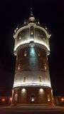 Старая водонапорная башня к ноча Стоковое Фото