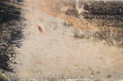 Старая выдержанная каменная поверхность - винтажная предпосылка песчаника с тенями желтого цвета, черноты и серого цвета Стоковые Фото