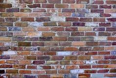 Старая, выдержанная кирпичная стена Стоковые Изображения RF