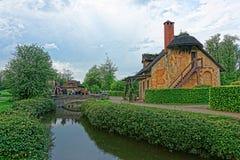 Старая деревня Мари Antoinette и дворца Версаль Парижа Стоковая Фотография