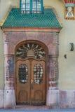Старая деревянная дверь с грилями Стоковая Фотография RF