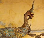 Старая деревянная скульптура Naga в виске Lao Стоковая Фотография