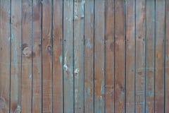 Старая деревянная текстура загородки с некоторой пакостной голубой краской Стоковое Фото