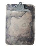Старая запятнанная доска сзажимом для бумаги Стоковые Фото