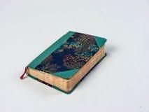 Старая зеленая и голубая тетрадь с флористическим украшением Стоковое Изображение