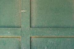 Старая зеленая предпосылка двери гаража Стоковые Фото