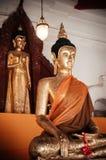 Старая золотая скульптура Будды на Wat Phra Mahathat Nakhon Si Thamm Стоковое Изображение