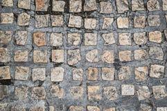 Старая и пакостная каменная текстура дороги Стоковые Изображения