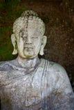 Старая каменная статуя Будды. Индонезия, Бали. Стоковое Изображение