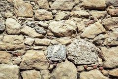 Старая каменная стена, архитектурноакустическая деталь Стоковое Изображение