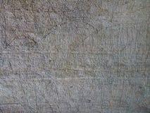Старая каменная текстура предпосылки Поцарапанная картина стены пещеры ржавая Стоковое Изображение RF