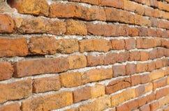 Старая кирпичная стена, красный каменный кирпич, древняя стена Стоковое Фото