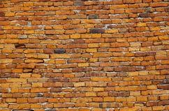 Старая кирпичная стена, красный каменный кирпич, древняя стена Стоковые Изображения