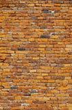 Старая кирпичная стена, красный каменный кирпич, древняя стена Стоковая Фотография
