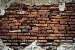 Старая кирпичная стена, старая текстура красного камня преграждает крупный план Стоковое Фото