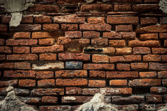 Старая кирпичная стена, старая текстура красного камня преграждает крупный план Стоковая Фотография