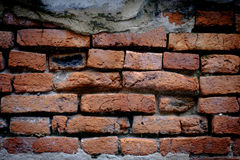 Старая кирпичная стена, старая текстура красного камня преграждает крупный план Стоковые Изображения RF