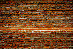 Старая кирпичная стена, старая текстура красного камня преграждает крупный план Стоковая Фотография RF
