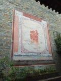Старая кирпичная стена с ТЕРПЕНИЕМ китайского характера Стоковое фото RF