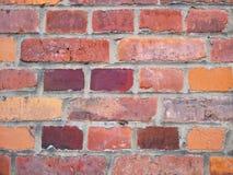 Старая кирпичная стена, старая текстура красного камня преграждает крупный план Стоковые Изображения