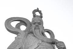 Старая китайская статуя человека на белой предпосылке Стоковое Изображение