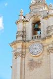 Старая колокольня под голубым небом Стоковое Фото