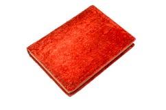 Старая красная закрытая книга изолированная на белом backdrown Стоковые Изображения RF