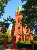 Старая красная красивая церковь, Латвия Стоковая Фотография RF